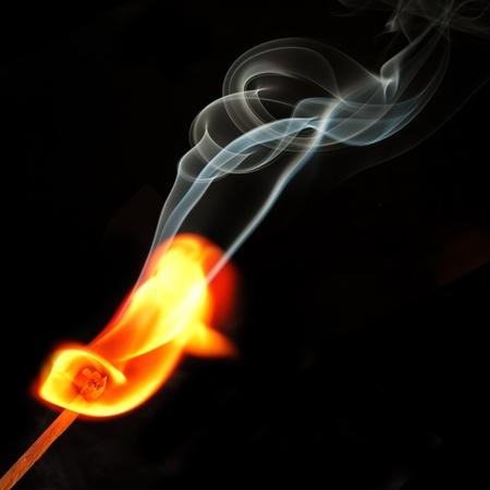 Fire and smoke from match photo