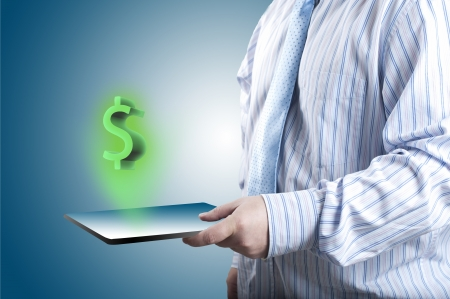Dollar Sign Coming out of Touch screen tablet PC  Concept of business growth Stock Photo - 14257195