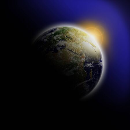 Sunrise behind earth in outer space photo