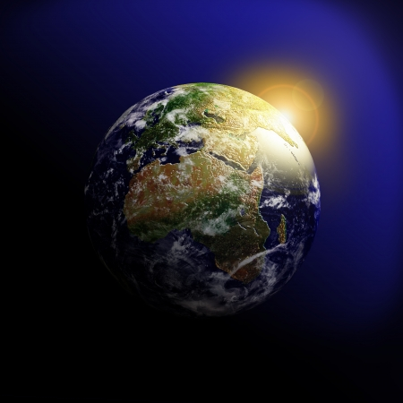 globe hand: Sunrise behind earth in outer space