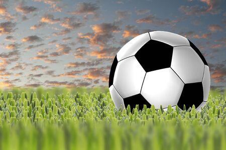 Soccer ball on sunset sky photo