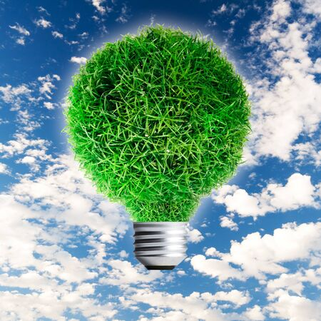 Green Grass growing on Light bulb on clear blue sky  Concept for eco-friendly Stock Photo - 13733034