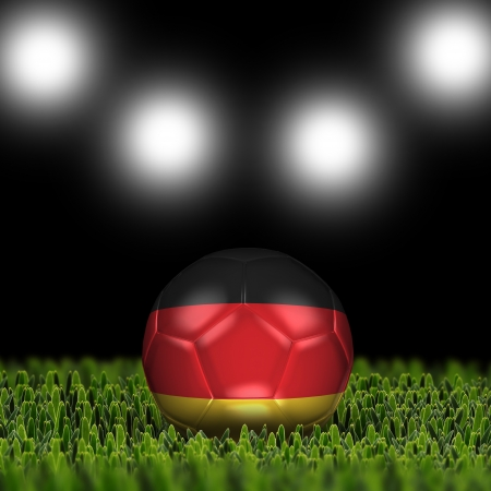 National Flag on the soccer ball on green grass with stadium lighting  Country Germany  photo