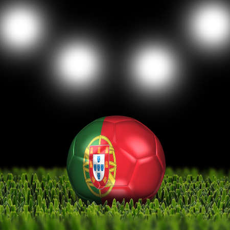 National Flag on the soccer ball on green grass with stadium lighting  Country Portugal photo