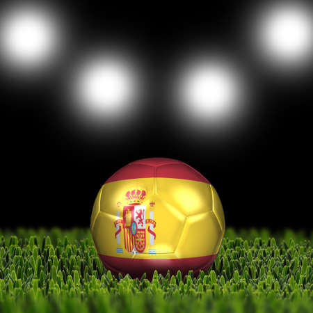 National Flag on the soccer ball on green grass with stadium lighting  Country Spain photo