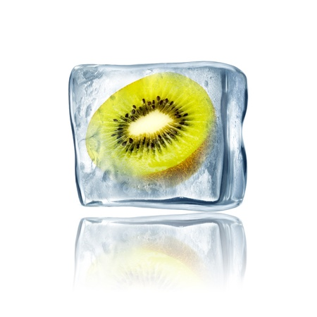 Green Kiwi frozen inside big ice cube photo