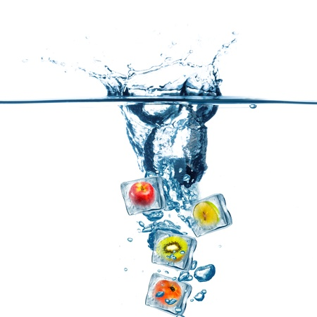 fruit drop: Various Fruit frozen in ice cube drop on water  Water splash Stock Photo