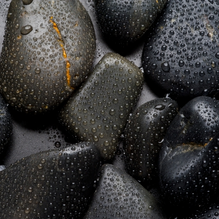 Close up on black stone and water drop  Concept for spa and relaxation photo