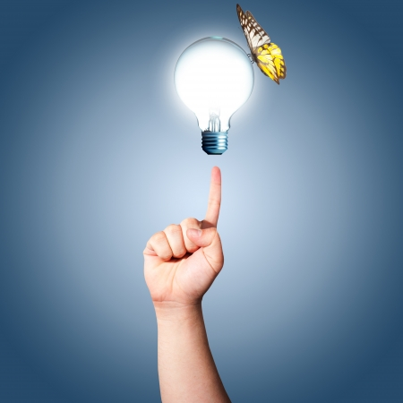 technological: Hand pointing to the glowing light bulb with butterfly  Concept for eco friendly Stock Photo