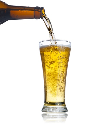 booze: Pouring beer from beer bottle to cold glass