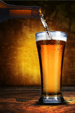 beer bottle: Pouring beer from beer bottle to cold glass