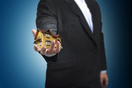 House in a business man s hand  Concept for real estate photo