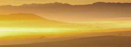 Panorama shot of desert sand dunes at sunrise photo