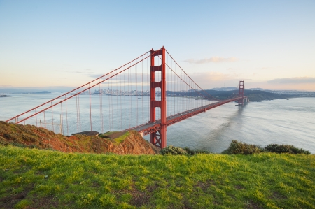 Golden Gate bridge in clear blue sky with green grass as foreground  San Francisco, USA   photo