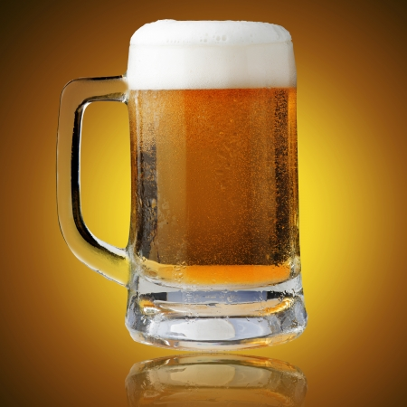 Fresh beer in glass with foam on yellow background Stock Photo - 15842701