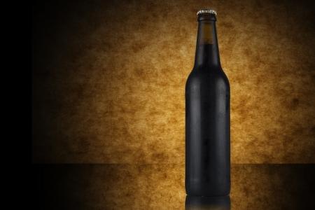 brown bottle: Dark beer bottle on yellow background