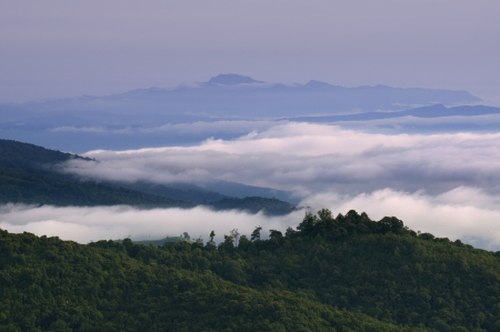Layer of mountain in Thailand with cloud photo