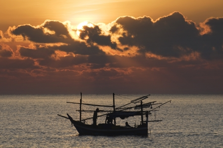 Fisherman in boat at sea photo