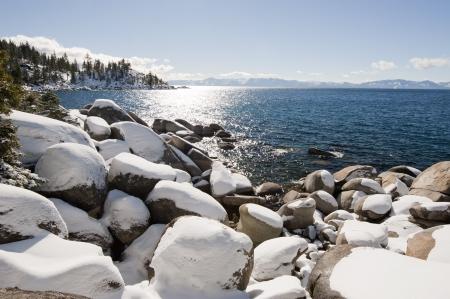 Snow on rock at Lake Tahoe, California, USA photo