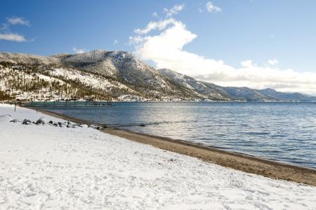 Snow at the beach of Lake Tahoe, California, USA photo