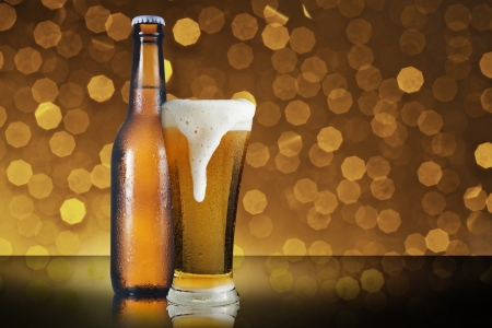 Bottle and glass of beer with beautiful bokeh background photo