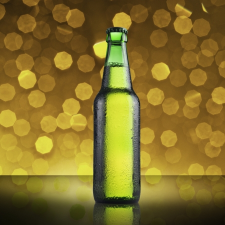 Green gottle of beer with beautiful bokeh background photo