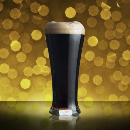 Glass of dark beer with beautiful bokeh background photo