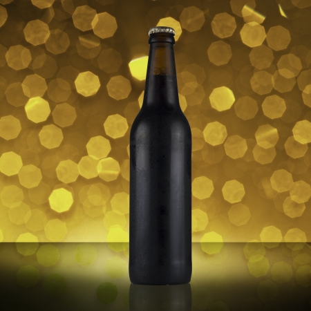 Bottle of dark beer with beautiful bokeh background photo
