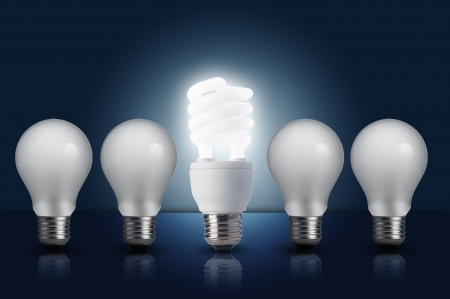 filament: Incandescent light bulb in a row with middle fluorescent light bulb on  Concept for energy conservation