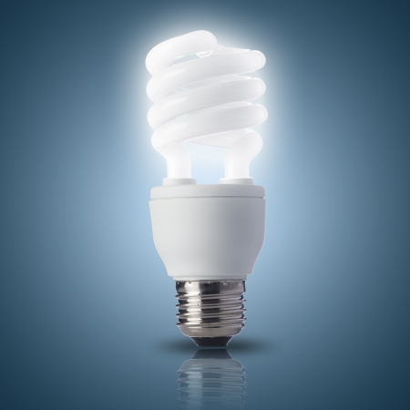 Light bulb turn on with blue background photo