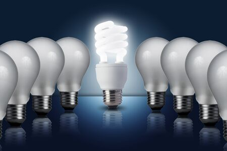 Fluorescent Light bulb turn on in middle of the other light bulbs  Concept for energy conservation Stock Photo - 16596116