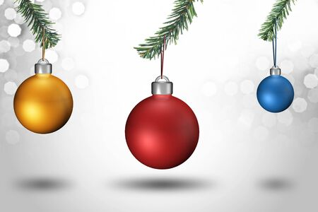 Red, yellow and blue christmas ball hanging from christmas tree on bokeh background photo