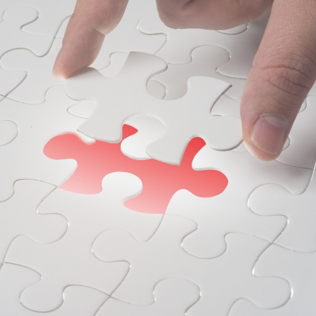 Complete missing jigsaw puzzle  Concept for success Stock Photo - 16665220
