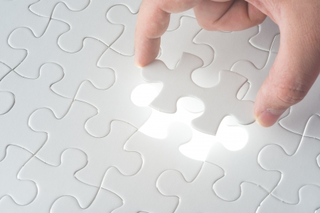 search solution: Complete missing jigsaw puzzle  Concept for success Stock Photo