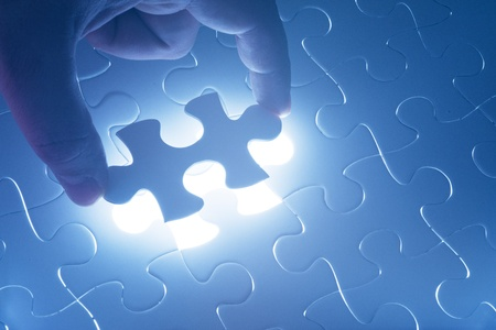 Complete missing jigsaw puzzle  Concept for success photo