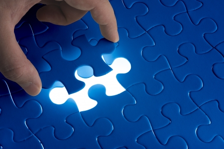 problem: Complete missing jigsaw puzzle  Concept for success Stock Photo