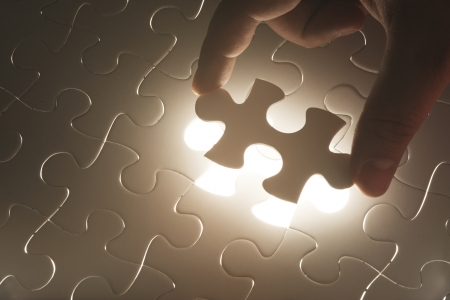 join hand: Missing jigsaw puzzle  Concept for completeness Stock Photo