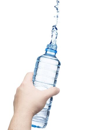 Hand holding the water bottle with water splash  photo