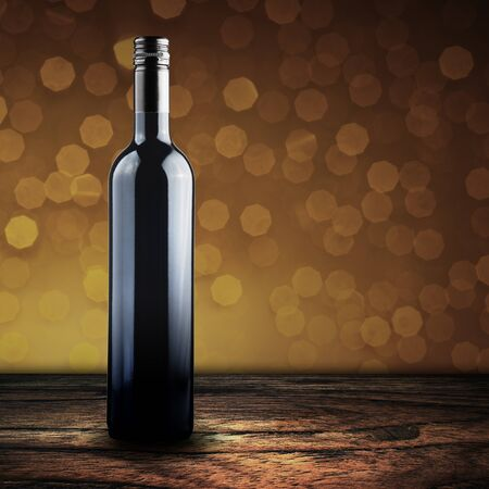 grunge bottle: Wine bottle on wood floor with bokeh background Stock Photo