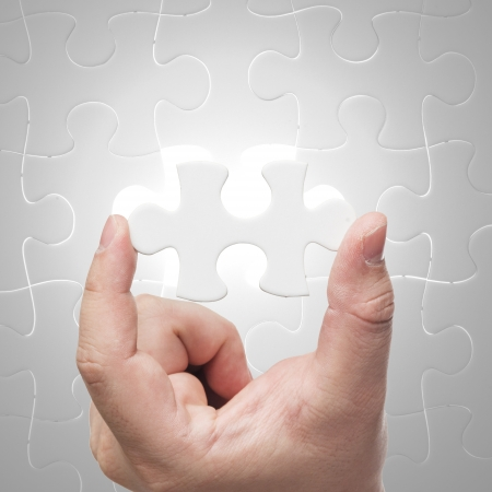 Missing jigsaw puzzle piece with light glow, business concept for completing the final puzzle piece  Stock Photo - 17152004