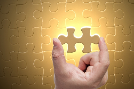 Missing jigsaw puzzle piece with light glow, business concept for completing the final puzzle piece Stock Photo - 17152013