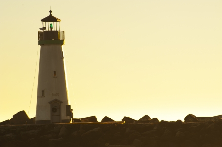 lighthouse keeper: Lighthouse with sunset sky Stock Photo