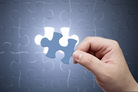 complete solution: Missing jigsaw puzzle piece with light glow, business concept for completing the final puzzle piece