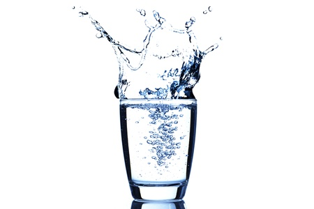 cup of water: Water splash from glass