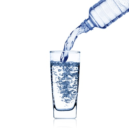welling: Water pour from water bottle to glass