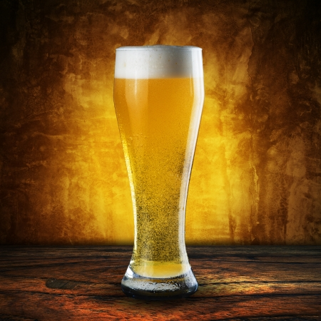 glass of beer: Glass of beer on wood table