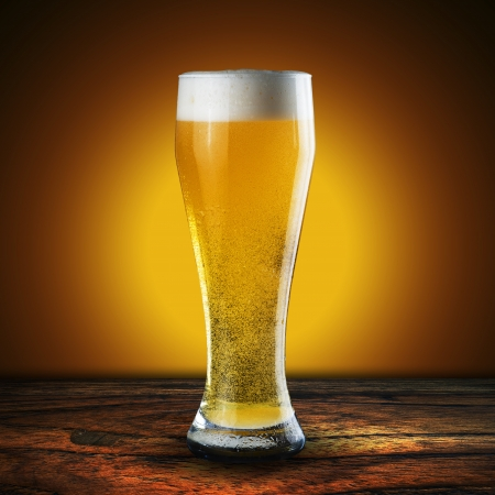 Glass of beer on wood table Stock Photo - 18091500