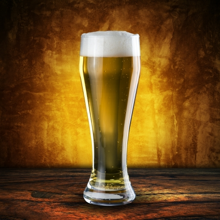 Glass of beer on wood table Stock Photo - 18091506