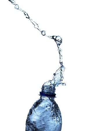 purification: Water splash from bottle Stock Photo