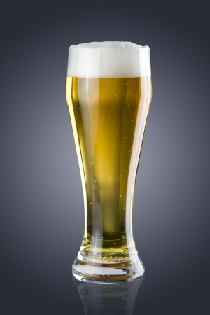brewing: Glass of beer on grey background